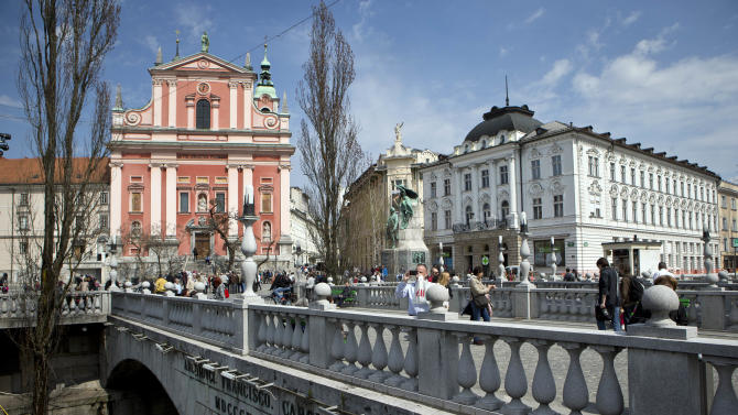 In this picture taken April 16, 2013 downtown Ljubljana, Slovenia, is photographed. In the Alpine country which joined the EU in 2004, the banks have for years unselectively credited unprofitable state companies or privileged officials who used the cash to buy firms they ran, using the state assets as collateral. (AP Photo/Darko Bandic)