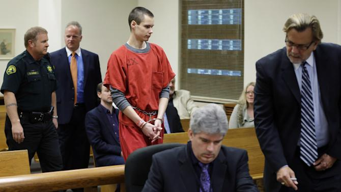 "Colton Harris-Moore, center, known as the ""Barefoot Bandit,"" is led into a Skagit County Superior Courtroom, Wednesday, May 8, 2013, in Mount Vernon, Wash., as his attorney, John Henry Browne, right, consults with Skagit County Deputy Prosecutor Eric Peterson, second from right. Harris-Moore pleaded guilty Wednesday to a burglary charge for stealing an airplane and flying it to Orcas Island, Wash., but as part of a plea deal with Skagit County Prosecutor Rich Weyrich, the 22-year-old was sentenced to three months he's already spent in jail and he will return to serving his seven-year prison sentence for other crimes. (AP Photo/Ted S. Warren)"
