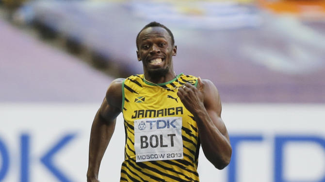 Jamaica's Usain Bolt competes in a men's 200-meter semifinal at the World Athletics Championships in the Luzhniki stadium in Moscow, Russia, Friday, Aug. 16, 2013. (AP Photo/Anja Niedringhaus)
