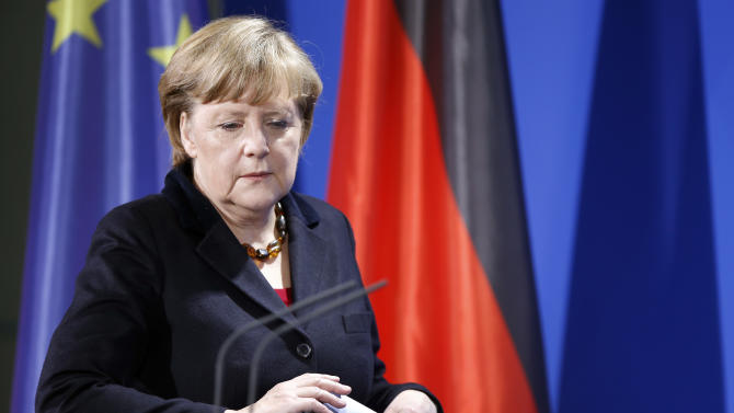 "German Chancellor Angela Merkel arrives for a statement at the chancellery in Berlin, Germany, Monday, Feb. 11, 2013. Merkel says she has the ""very highest respect"" for German-born Pope Benedict XVI's decision to step down. Further she told reporters after the pontiff's announcement: ""As chancellor, I thank Benedict XVI for his work and wish him from the bottom of my heart all the best for the coming years."" (AP Photo/Michael Sohn)"