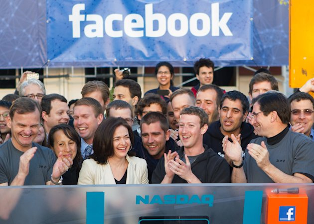 In this image provided by Facebook, Facebook founder, Chairman and CEO Mark Zuckerberg, center, applauds at the opening bell of the Nasdaq stock market, Friday, May 18, 2012, from Facebook headquarter