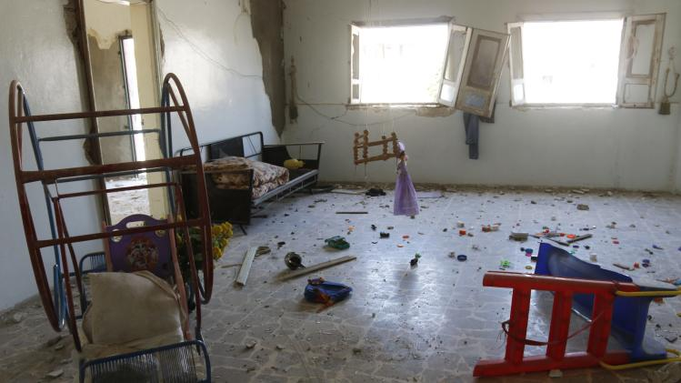 Toys are seen inside a damaged room in the town of Morek in Hama province