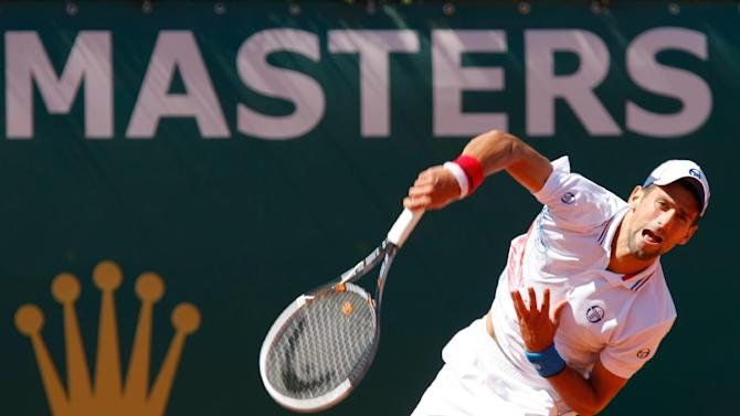 Serbia's Novak Djokovic  serves the ball  to Netherlands' Robin Haase, during their quarterfinal match of the Monte Carlo Tennis Masters tournament, in Monaco, Friday, April 20, 2012. (AP Photo/Claude Paris)