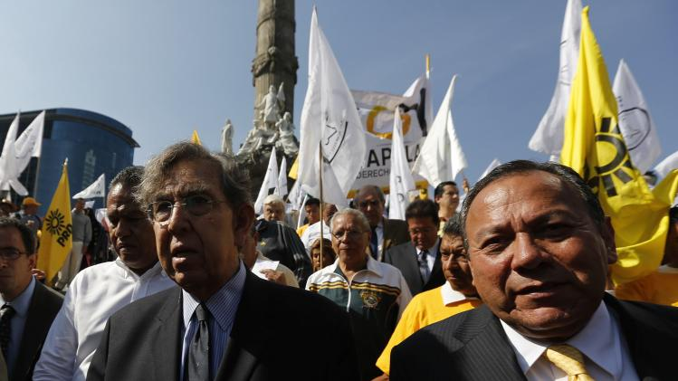 Cardenas, founder of the PRD and party's president Zambrano attend a rally against the energy reform bill at the Angel of Independence in Mexico City