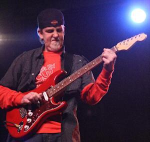 """This March 20, 2011 photo released by Barry Sigman Photography shows Stuart Swanlund of the Marshall Tucker Band performing at Nutty Jerry's in Winnie, Texas. Swanlund died in his sleep of natural causes Saturday, Aug. 4, 2012 at his Chicago home. He was 54. Swanlund joined the band in 1985 after it had split up and regrouped. He was the longest running member of the group except for founding member Doug Gray. The group is best known for its 1977 Top 40 hit """"Heard It In a Love Song."""" (AP Photo/Barry Sigman Photography)"""