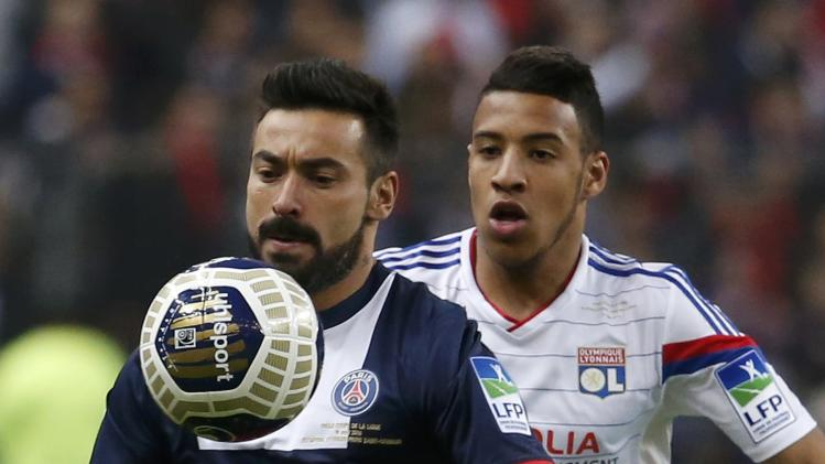 Paris St Germain's Lavezzi challenges Olympique Lyon's Kone during their French League Cup final soccer match at the Stade de France stadium in Saint-Denis
