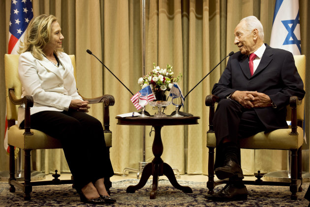 Israel's President Shimon Peres, right, and U.S. Secretary of State Hillary Rodham Clinton, left, meet at the President's residence in Jerusalem, Monday, July 16, 2012. Clinton made perhaps her final