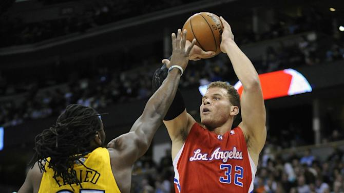 Los Angeles Clippers forward Blake Griffin (32) shoots against Denver Nuggets forward Kenneth Faried (35) during the first quarter of an NBA basketball game, Tuesday, Jan. 1, 2013, in Denver. (AP Photo/Jack Dempsey)