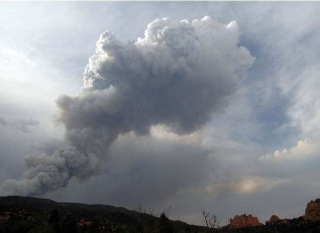 A giant plume from the Waldo Canyon Fire hovers high above  Garden of the Gods near Colorado Springs, Colo. on Saturday, June 23, 2012.  The fire is zero percent contained and has consumed 2500 acres.