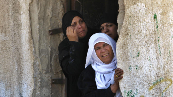 Palestinian women follow the funeral of Islamic Jihad militant Ahmad Hajaj in Gaza City, Saturday, March 10, 2012. The worst violence between Israel and the Gaza Strip in nearly a year entered its second day on Saturday, as Israeli aircraft killed 14 militants, according to Palestinian health officials. Militants responded by firing nearly 100 rockets, seriously wounding an Israeli civilian. (AP Photo/Adel Hana)