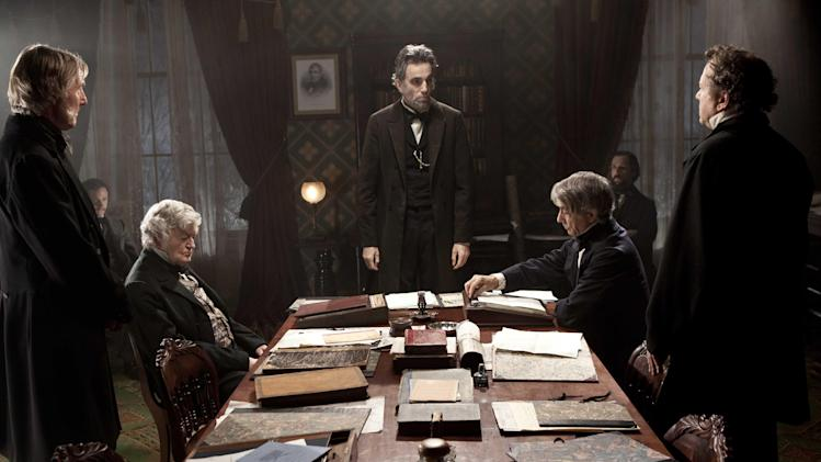 "FILE - This undated publicity photo released by DreamWorks and Twentieth Century Fox shows, Daniel Day-Lewis, center rear, as Abraham Lincoln, in a scene from the film, ""Lincoln."" The film was nominated for a Golden Globe for best drama on Thursday, Dec. 13, 2012. Daniel Day Lewis was also nominated for best actor. The 70th annual Golden Globe Awards will be held on Jan. 13.  (AP Photo/DreamWorks, Twentieth Century Fox, David James, File)"