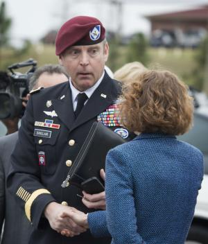 Brig. Gen. Jeffrey Sinclair shakes hands with his defense attorney Ellen C. Brotman outside the Fort Bragg, N.C., courthouse, Monday, March 17, 2014. Sinclair, who admitted to improper relationships with three subordinates, appeared to choke up as he told a judge that he'd failed the female captain who had leveled the most serious accusations against him. (AP Photo/The Fayetteville Observer, Johnny Horne)