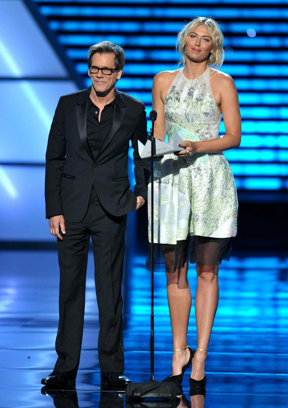 Kevin Bacon, left, and Maria Sharapova present an award at the ESPY Awards on Wednesday, July 17, 2013, at the Nokia Theater in Los Angeles. (Photo by John Shearer/Invision/AP)