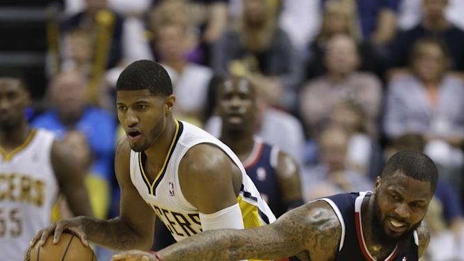 Indiana Pacers' Paul George, left, grabs a rebound from Atlanta Hawks' DeShawn Stevenson during the second half of Game 1 in the first round of the NBA basketball playoffs on Sunday, April 21, 2013, in Indianapolis. Indiana defeated Atlanta 107-90. (AP Photo/Darron Cummings)