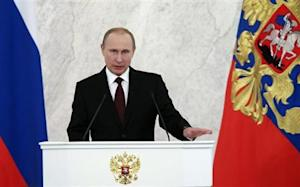 Russia's President Putin speaks during his annual state of the nation address at the Kremlin in Moscow