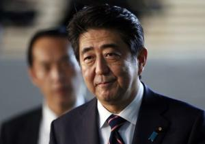 Japan's Prime Minister Abe walks into the Prime Minister's official residence in Tokyo