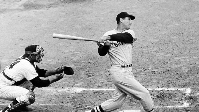 FILE -  In this April 18, 1960 file photo, Ted Williams of the Boston Red Sox knocks the ball out of the park for a home run in the second inning against the Washington Senators. There's finally a better matchup than Monday Night Football on another channel. Hillary vs. The Donald. If the debate were a baseball game, Hillary Clinton would be a reliable contact hitter with decent power. She can use the whole field, bunt or move the runner over when called for _ in short, Ted Williams. (AP Photo, File)