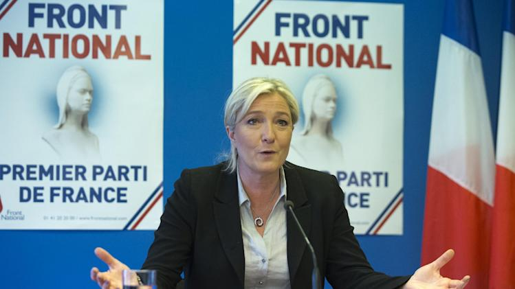 French far-right National Front party leader Marine Le Pen speaks at a meeting at their headquarters in Nanterre, west of Paris, Tuesday, May 27, 2014. The anti-EU, anti-immigration National Front party shook France's political landscape by coming out on top in France's voting for European Parliament elections, beating the mainstream conservatives and the governing Socialists. (AP Photo/Jacques Brinon)