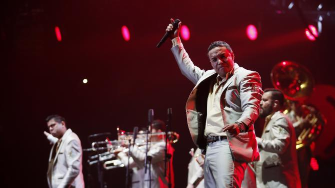 Members of the band La Original Banda El Limon perform during the first-ever iHeartRadio Fiesta Latina at The Forum in Inglewood, California
