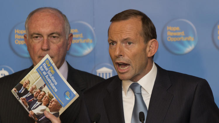 Australian Opposition leader Tony Abbott, right, makes a statement to the media as leader of the Nationals party, Warren Truss stands next to him after the Labour party called for a leadership ballot in Canberra, Australia, Thursday, March 21, 2013. Julia Gillard remains Australia's prime minister after she was forced to threw her job open to a leadership ballot on  but no one from the government was willing to run against her. (AP Photo/Rob Griffith)