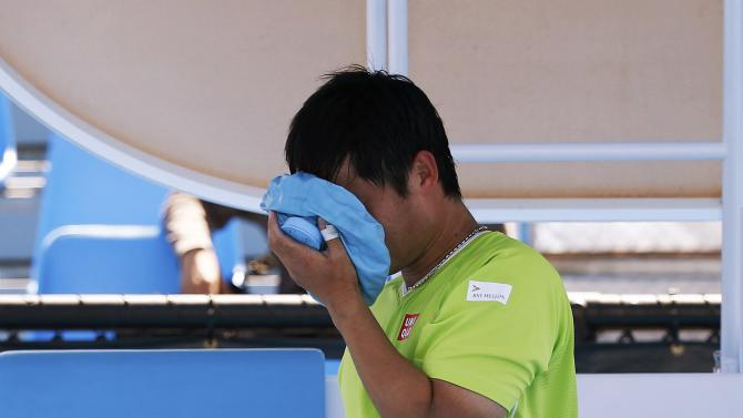 Kunieda of Japan applies an ice pack on his face during a break in his men's wheelchair singles final match against Houdet of France at the Australian Open 2015 tennis tournament in Melbourne