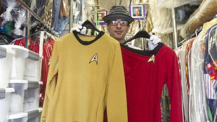 "In this Friday, Nov. 30, 2012 photo, James Comisar shows costumes from the ""Star Trek"" original series. The items are part of his television memorabilia collection in a temperature- and humidity-controlled warehouse in Los Angeles. (AP Photo/Damian Dovarganes)"