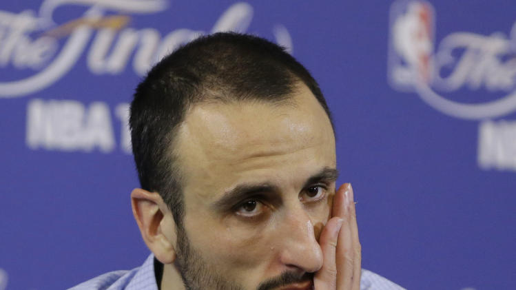 San Antonio Spurs guard Manu Ginobili of Argentina listens to a questions during the post-game news conference following Game 6 of the NBA Finals basketball game against the Miami Heat, Wednesday, June 19, 2013 in Miami. The Heat defeated the Spurs 103-100. (AP Photo/Wilfredo Lee)