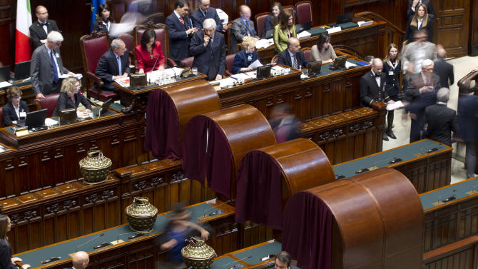 Italian lawmakers gather at the lower chamber to vote a new president, in Rome, Friday, April 19, 2013. Italy's Parliament has opened a third round of voting for the nation's president after two inconclusive votes a day earlier. In a bid to change the dynamic during Friday's voting, the center-left leader proposed former Premier Romano Prodi for the post. However, Silvio Berlusconi's center-right has already signaled its opposition to the man who twice beat Berlusconi in national elections. (AP Photo/Andrew Medichini)