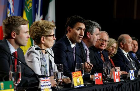 Canada agrees on national carbon price, but tensions remain