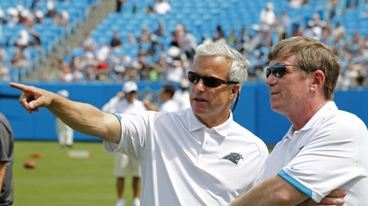 FILE - In this Aug. 4, 2012 file photo, Carolina Panthers' team president Danny Morrison, left, talks with general manager Marty Hurney during the NFL Carolina Panthers' Fan Fest football practice in Charlotte, N.C. The Panthers fired Hurney Monday, Oct. 22, 2012 following the team's 1-5 start this season. (AP Photo/Bob Leverone, File)