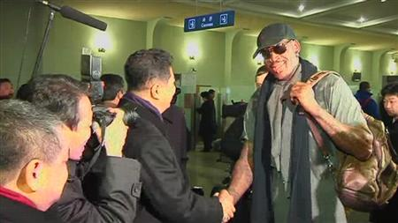Retired U.S. NBA basketball player Dennis Rodman is welcomed by Son Kwang-ho, Vice Chairman of North Korea's Olympic Committe, as he arrives at an airport in Pyongyang in this still image taken from video, February 26, 2013. REUTERS/KCNA for REUTERS TV