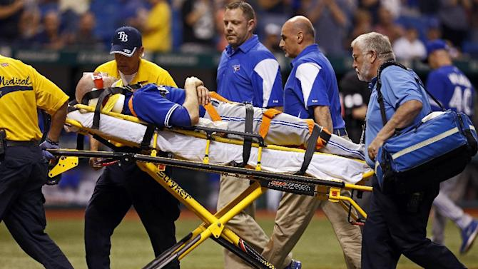 Toronto Blue Jays starting pitcher J.A. Happ is taken off the field on a stretcher after being hit with a line drive off the bat of Tampa Bay Rays' Desmond Jennings during the second inning of a baseball game Tuesday, May 7, 2013, in St. Petersburg, Fla. (AP Photo/Mike Carlson)