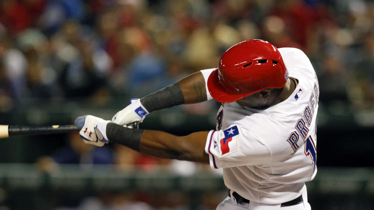 Texas Rangers' Jurickson Profar (13) hits a single against the Oakland Athletics during the sixth inning of a baseball game, Tuesday, May 21, 2013, in Arlington, Texas. (AP Photo/Jim Cowsert)