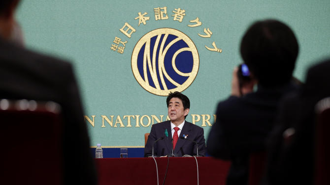 "Japanese Prime Minister Shinzo Abe, center, speaks during a press conference at the Japan National Press Club in Tokyo, Friday, April 19, 2013. Abe said reviving Japan's growth will depend on further opening the economy and tapping the underutilized potential of its women and advanced technology. Abe outlined the next steps of his grand plan for restoring Japan's economic power Friday, describing a slew of initiatives he said would help awaken Japan's ""sleeping dynamism."" (AP Photo/Shizuo Kambayashi)"
