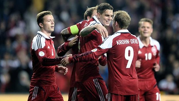 Denmark's Daniel Agger (C) celebrates with teammates after scoring twice against Malta (AFP)