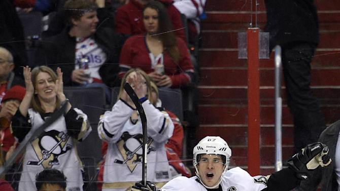 Malkin's 3 assists lead Penguins past Capitals 4-3