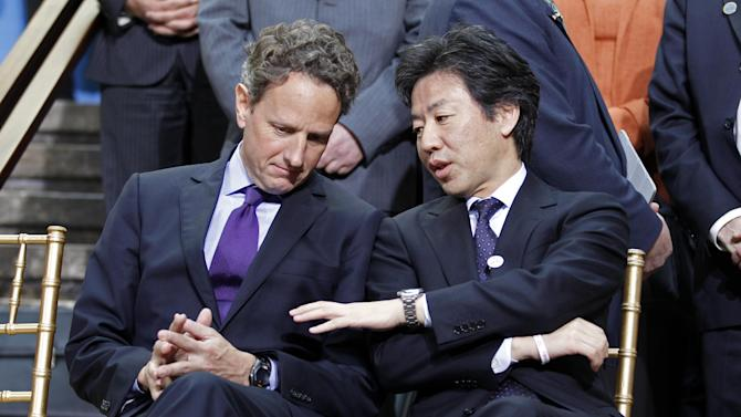 U.S. Treasury Secretary Timothy Geithner, left, speaks with  Japan's Finance Minister Jun Azumi, while waiting during a group photo opportunity at the IMF/World Bank spring meetings in Washington Saturday, April, 21, 2012.