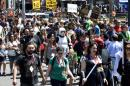 Crowds cross the street outside the convention center on Day 3 at the 2014 Comic-Con International Convention held Saturday, July 26, 2014, in San Diego. (Photo by Denis Poroy/Invision/AP)