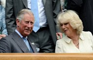 Prince Charles (L) and his wife Camilla, Duchess of Cornwall, in the Royal Box on Center Court before the Wimbledon second round men's singles match between Switzerland's Roger Federer and Italy's Fabio Fognini on June 27