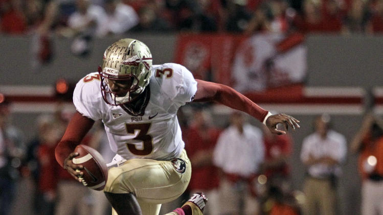 Florida State quarterback EJ Manuel (3) jumps over North Carolina State's Sterling Lucas (7) during the first half of an NCAA college football game in Raleigh, N.C., Saturday, Oct. 6, 2012. (AP Photo/Gerry Broome)