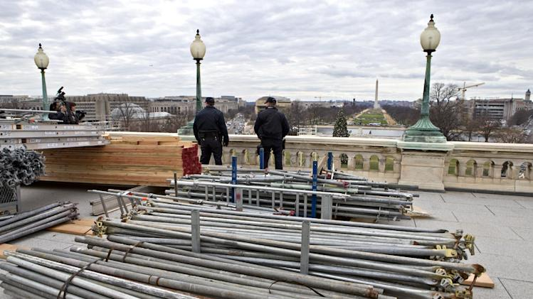 Materials for scaffolding is stacked on the west side of the Capitol in Washington, Tuesday, Dec. 11, 2012, awaiting construction workers who are making progress on the platforms for President Barack Obama's second inauguration, looking toward the Washington Monument.   (AP Photo/J. Scott Applewhite)