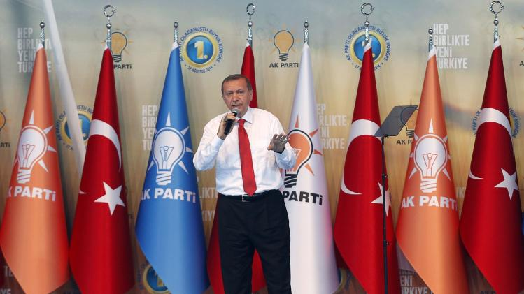Turkey's Prime Minister Tayyip Erdogan addresses the Extraordinary Congress of AKP in Ankara