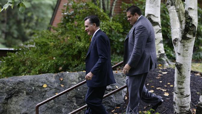 Republican presidential candidate and former Massachusetts Gov. Mitt Romney is accompanied by a U.S. Secret Service agent as he leaves the Church of Jesus Christ of Latter-day Saints, in Belmont, Mass., Sunday, Sept. 30, 2012. (AP Photo/Charles Dharapak)
