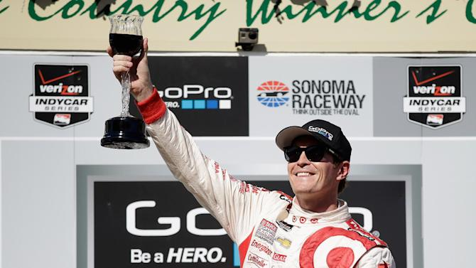Scott Dixon toasts the crowd after winning the IndyCar Grand Prix of Sonoma on August 24, 2014 in Sonoma, California