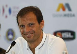 Juventus coach Massimiliano Allegri smiles as he speaks to reporters during a news conference in Jakarta