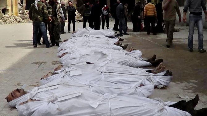 FILE - This file citizen journalism image taken on, Sunday, March. 10, 2013 and provided by Aleppo Media Center AMC which has been authenticated based on its contents and other AP reporting, shows Syrians standing next to dead bodies that have been pulled from the river near Aleppo's Bustan al-Qasr neighborhood, Syria. More than 6,000 people were killed in the Syrian civil war in March alone, according to a leading activist group that reported it was the deadliest month yet in the 2-year-old conflict. (AP Photo/Aleppo Media Center AMC, File)