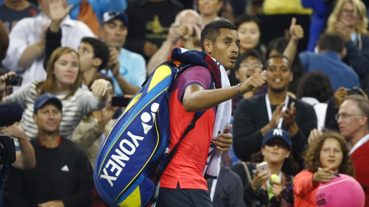 Nick Kyrgios of Australia leaves the court after losing to Tommy Robredo of Spain following their men's singles match at the 2014 U.S. Open tennis tournament in New York