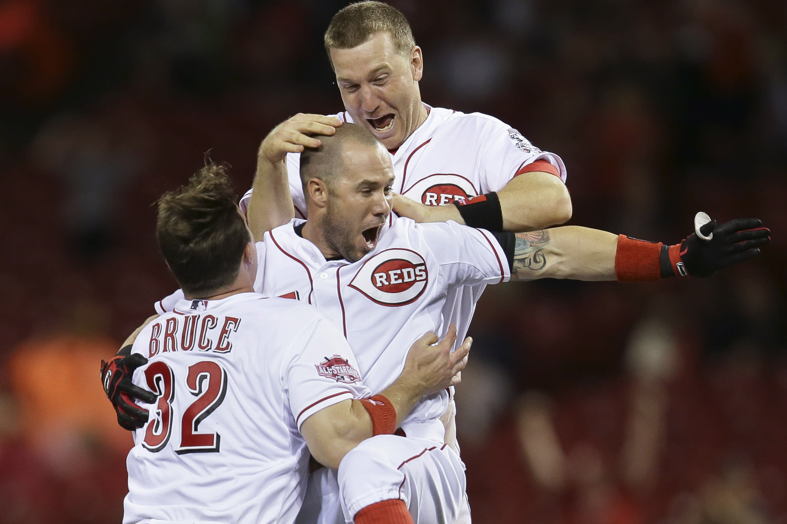 Reds end 9-game losing streak with 2-1 win over Rockies