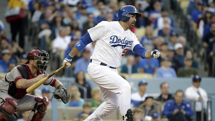 Los Angeles Dodgers' Adrian Gonzalez, right, hits a two-RBI single during the fifth inning of a baseball game against the Arizona Diamondbacks, Saturday, April 19, 2014, in Los Angeles