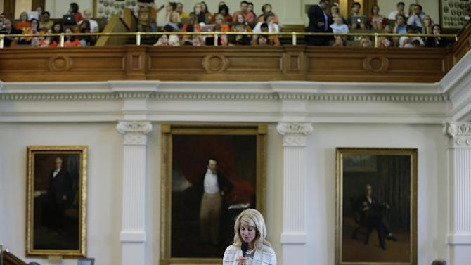 FILE - In this June 25, 2013 file photo, Sen. Wendy Davis, D-Fort Worth, is speeks during her filibuster of an abortion bill, Tuesday, June 25, 2013, in Austin, Texas. The bill will get another chance next week now that the Gov. Rick Perry has called another special legislative session. (AP Photo/Eric Gay)